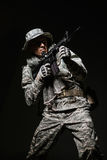 Special forces soldier man with Machine gun on a  dark background Royalty Free Stock Photo