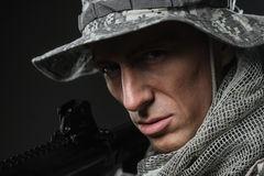 Special forces soldier man with Machine gun on a  dark background Stock Image