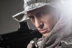 Special forces soldier man with Machine gun on a  dark background Stock Photo