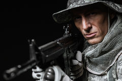 Special forces soldier man with Machine gun on a  dark background Stock Photography