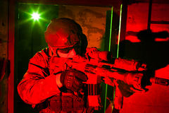 Special forces soldier during night mission. Special forces soldier/anti-terrorist unit policeman or private military/security contractor during night mission/ royalty free stock photography