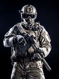 Special forces soldier. With rifle on dark background