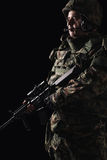 Special forces soldier with rifle on dark background royalty free stock photo