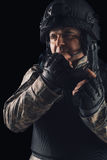 Special forces soldier with rifle on dark background Stock Photography