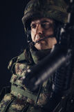 Special forces soldier with rifle on dark background Royalty Free Stock Image