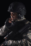 Special forces soldier with rifle on dark background stock image