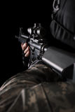 Special forces soldier with rifle on dark background Stock Photo
