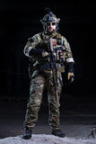 Special forces soldier with rifle on dark background royalty free stock photography