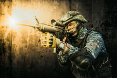 Special Forces soldier. Shooting with a gun in his hand Royalty Free Stock Images