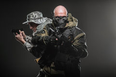 Special forces soldiers men with Machine gun on a dark background. Military, war, conflict, soldiers - Special forces soldiers men hold Machine gun on a dark stock photography