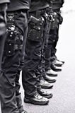 Special forces soldiers with pistols in scabbards Royalty Free Stock Photos