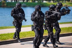 Special forces tactical team of four in action. Unmarked and unrecognizable swat team royalty free stock images