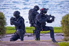Special forces tactical team of three in action. Unmarked and unrecognizable swat team royalty free stock image