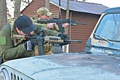 Special Forces Team. A special forces team fires from cover Royalty Free Stock Photography