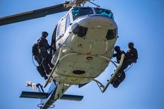 Special forces team ready for helicopter rope jumping. Unmarked and unrecognizable swat team royalty free stock images