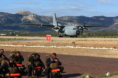Special forces waiting for transport plane Stock Photo
