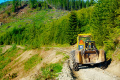 Special forestry tractors, Tractor on forest road. Stock Photos
