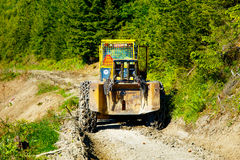 Special forestry tractors, Tractor on forest road. Royalty Free Stock Photography