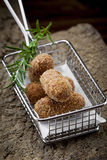 Special fried Jamon Iberico Croquette in iron basket with rosema Stock Photo