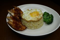 Special fried rice with spicy chili fried chicken sauce, broccoli and fried omelet royalty free stock photos