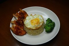 Special fried rice with spicy chili fried chicken sauce, broccoli and fried omelet royalty free stock photo