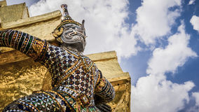 Special of giants statue with elephant trunk under golden pagoda Royalty Free Stock Photo