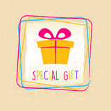 Special gift with present box sign in frame over old paper backg Royalty Free Stock Photo