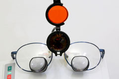 Special glasses with four lenses and an infrared beacon for Surg Stock Image
