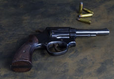 .38 special hand gun on rustic background Stock Images