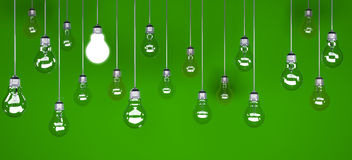 Special ideia. One lit lightbulb, on green background with other unlit ones Royalty Free Stock Photography