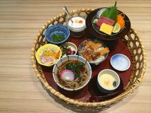 Special Japanese traditional meal on the basket, variety of Japanese food, Salmon and Tuna sashimi, Pork cutlet Tonkatsu rice bowl Stock Photography