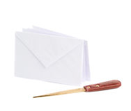 Special knife next to pile of envelopes Royalty Free Stock Images