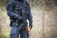 Special law enforcement unit. Special police force units in uniforms, bulletproof vests, firearms and guns. Masked police officers. Special Assault Team during stock photography