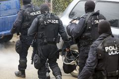 Special law enforcement unit. Special police force units in uniforms, bulletproof vests, firearms and guns. Masked police officers. Special Assault Team during stock photos