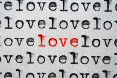 Special Love. Words love written with an old typewriter, one word written in red an standing out Stock Images