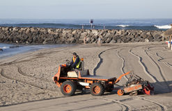 Special machine sifts the sand on the beach Stock Photo
