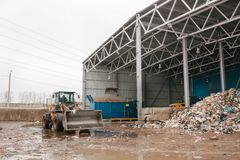 Special machinery or bulldozer work on the site of waste unloading at the plant for waste disposal. stock photography