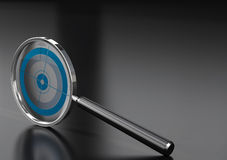 Special marketing tool. Magnifying glass  with a target in it, over a black background with reflection Stock Photography