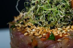 Special meal with beefsteak. Garlic and sesame royalty free stock photography