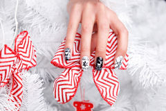 Special nails for christmas. Manicured and painted nails with winter motives stock photography