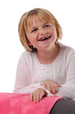 Special needs child smiling. Isolated on a white background stock image