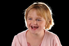 Special needs girl. Isolated against a black background stock photos