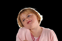 Special needs girl. Isolated against a black background Royalty Free Stock Photography