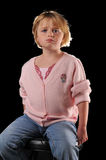 Special needs girl. Isolated against a black background stock photography