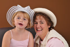 Special needs girl and her mother. Special needs girl with her mother isolated against a brown background royalty free stock photos
