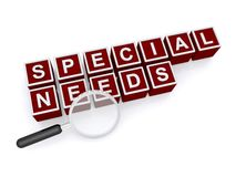 Special needs. In red and white toy blocks with magnifying glass on white Stock Photo