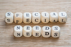 Special needs. Text on a wooden cubes on a wooden background royalty free stock image
