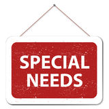 Special needs. Text 'special needs' in white uppercase letters on red inside a white frame hung from a nail on the wall, white background royalty free illustration