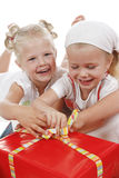 Special occasion. Two cute girls celebrating special occasion, unpacking gifts together Royalty Free Stock Photo