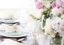 Special occasion dining with white pink and blue theme. Special occasion dining table place settings with white, pink and blue themed decor Stock Images